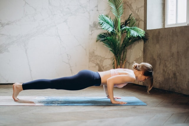 Happy Healthy During a Pandemic Woman Doing Yoga